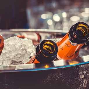 closeup-photo-of-liquor-bottles-on-bucket-with-ice (1)