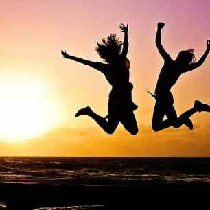 youth-active-jump-happy-sunrise-silhouettes-two-people-joy